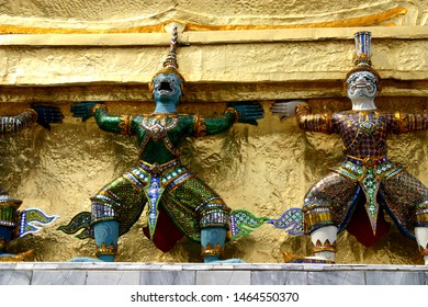Group of daemons and monkeys hold a pagoda roof in Wat Phra Kaeo
