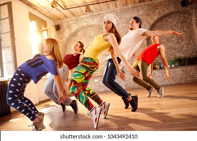 Group of dancers dancing together in dancing studio