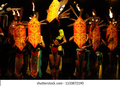 a group of Dayak dancers perform traditional warrior dance on Isen Mulang Festival in Palangka Raya, Central Borneo, Indonesia.