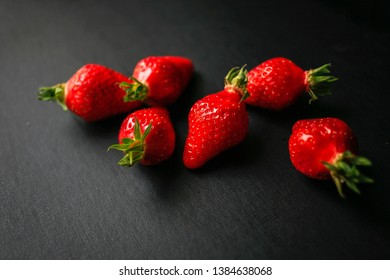 Group of delicious strawberrys on black background