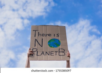 Group of demonstrators on road. Activists protesting on social issues. Race fight and climate change protesting activist during lockdown. global warming and environmental issues. Activists protesting