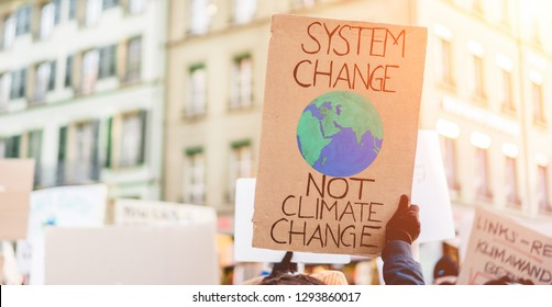 Group of demonstrators on road, young people fight for climate change - Global warming and enviroment concept - Focus on banner