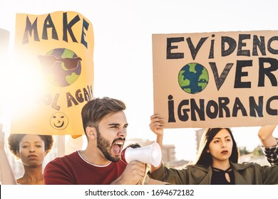 Group demonstrators protesting against plastic pollution and climate change - Multiracial people fighting on road holding banners on environments disasters - Global warming concept