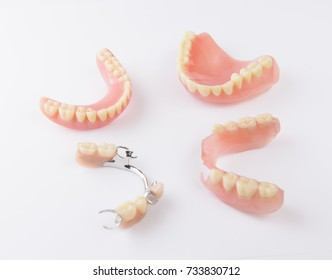 Group of dentures on white background