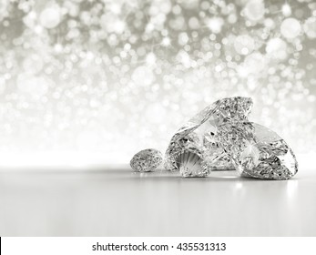 Group of diamonds placed on white background on the right with bokeh and light reflection, 3D illustration.