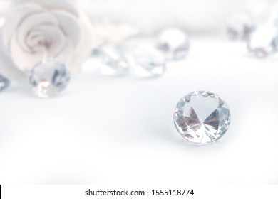 Group of diamonds and white rose on a white background.