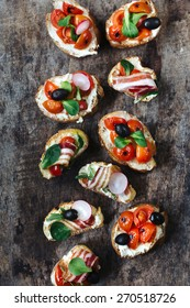 Group of different, bruschettas from above on wooden background,selective focus
