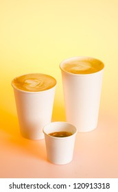 Group of different coffee drinks sizes in cardboard cups