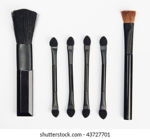 The group of different configurations makeup brushes isolated on white
