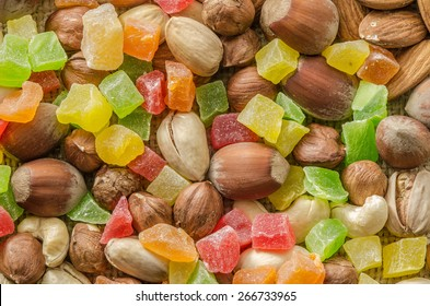 Group of different nuts and candied fruits isolated on bagging