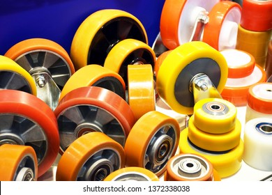 Group of different size and diameter industrial small wheels in warm yellow and orange colors for sale. Heavy Duty Fixed Polyurethane Industrial trolley Swivel Rubber Caster Wheels.