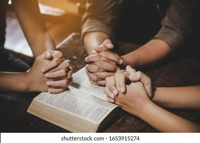 Group of different women praying together, Christians and Bible study concept.