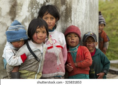 Group Of Dirty And Poorly Dressed Kid Due To The Lack Of Education And Basic Hygiene Services Living In A Rural Area