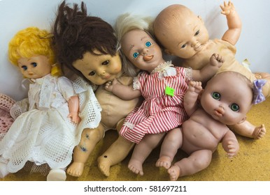 group of discarded toy dolls