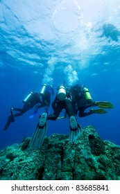 A group of diver doing safety stop near sea surface