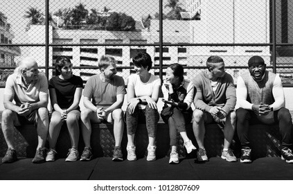Group of diverse athletes sitting together