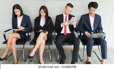 Group of diverse business man and woman sitting in office waiting for job interview.