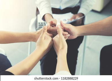Group of Diverse Business People Hands Together Thump up of business people. Team Work Business Concept
