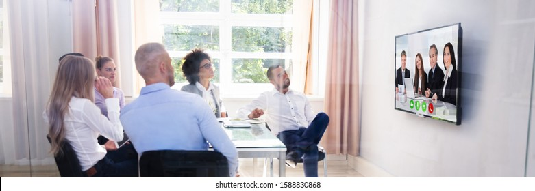 Group Of Diverse Businesspeople Video Conferencing In Boardroom