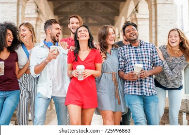 Group of diverse culture friends walking in city center with coffee paper cup - Happy people having fun together - Youth and friendship concept - Main focus on indian man