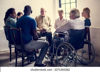Group of diverse elderly gathering together