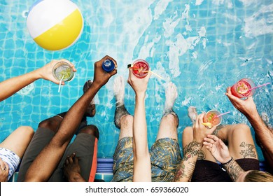 Group of diverse friends enjoying summer time with beverage