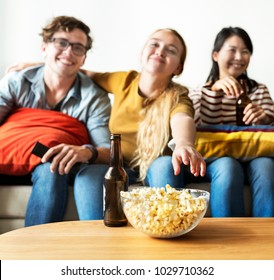 Group of diverse friends having a movie night