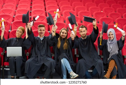 Group of Diverse International Graduating Students Celebrating, sitting and standing, concept