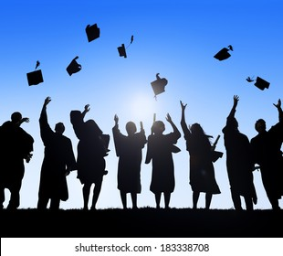 Group Of Diverse International Students Celebrating Graduation And Throwing Caps
