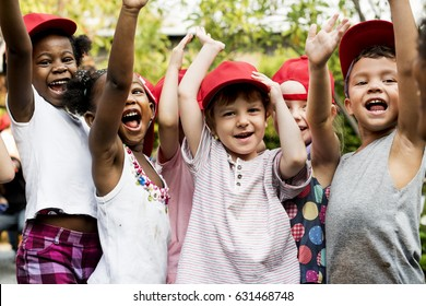 Group of Diverse Kids Hands Raising Up Cheerfully Together