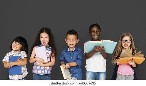Group of Diverse Kids Reading Books Together Studio Portrait