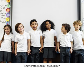 Group of diverse kindergarten students standing together