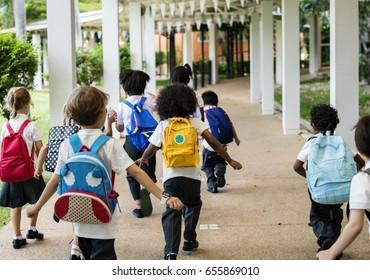 Group of diverse kindergarten students walking together