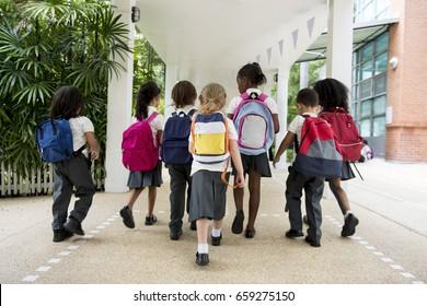Group of diverse kindergarten students walking together