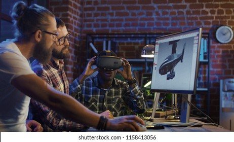 Group of diverse men using VR technology and developing modern visual effects for videogame and computing