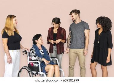 Group of Diverse People Talking with Handicap Woman Studio Portrait