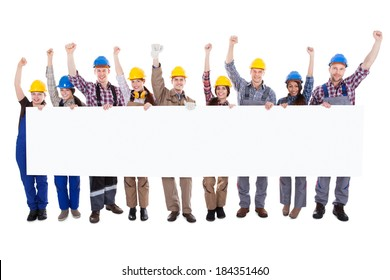 Group of diverse skilled motivated workmen and women standing in a line cheering celebrating a success holding a blank white banner with copyspace for your text on a white background