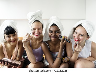Group of diverse women with makeup cosmetics