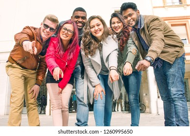 group of diverse young people looking at camera with a smile. concept of team work, batch mates friends or multi ethnic coworkers having fun together.