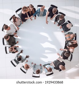 group of diverse young people at a round table meeting