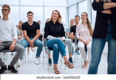 group of diverse young people sitting in a conference room