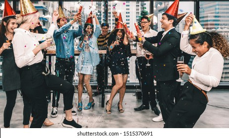 group of diversity business people having fun together in corporate new year and Christmas party with music and dancing at workplace