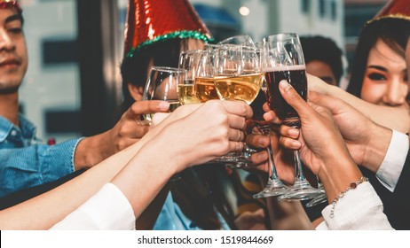 group of diversity businesspeople making toast together in corporate new year celebration party