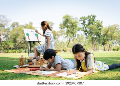 A group of diversity elementary school children enjoyed Paint a painting in the park. They do outdoor activities together. Friendship and Learning outside the classroom concept - Shutterstock ID 1928407307