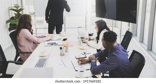Group diversity etchnicity working team brainstorming together in meeting board room at modern office