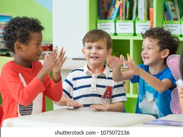Group of diversity kids boy sit on table and playing together in preschool library,Kindergarten school education concept.