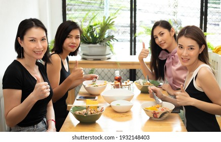Group of diversity people with Asian women and transgender, Food arrives and ready to eat. Friends show thumb up and smile to camera, copy space window