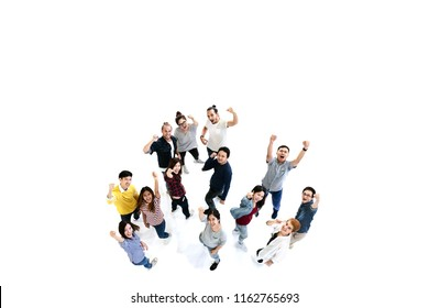 Group of Diversity People Team looking at camera with isolated white floor background. Creative teamwork feeling happy, enjoy and engage with achievement project with overhead aerial view concept.