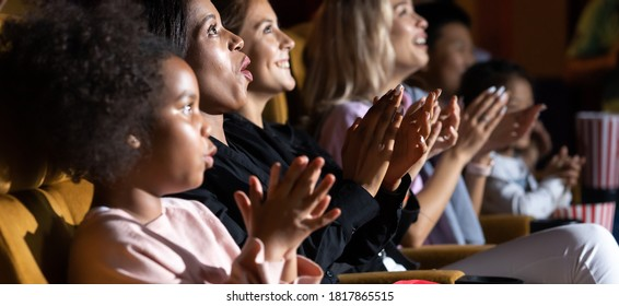 Group of diversity people watching movie in cinema theater with popcorn and drinks. Enjoy Happy laughing fun sad drama action movie concept.