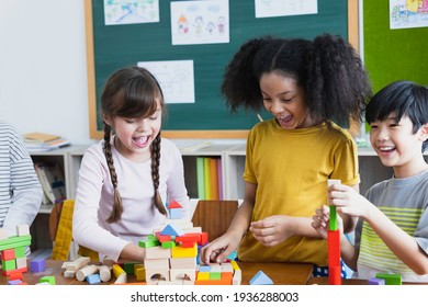 group of Diversity of school students playing wooden blocks in classroom. Elementary school children enjoy learning together. Learn to work as a team. Back to school concept